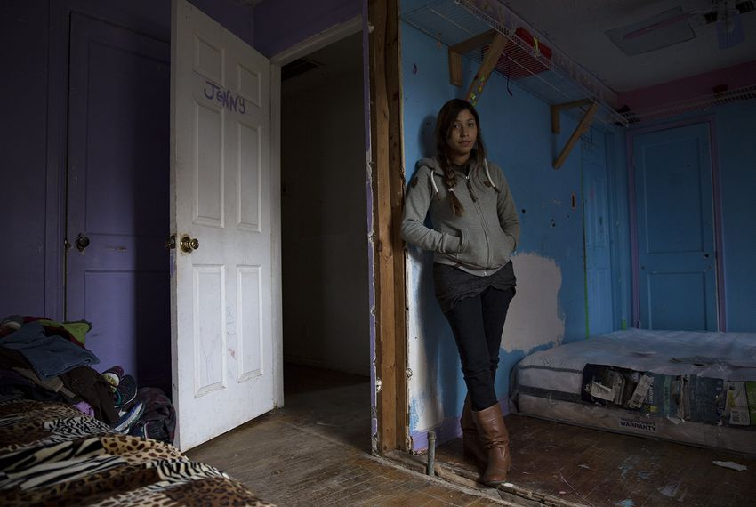 Anita Miranda in her family's flood-damaged house in Houston, where they are living without power, running water or heat after Miranda said FEMA cut them off from its hotel assistance program for Hurricane Harvey victims.