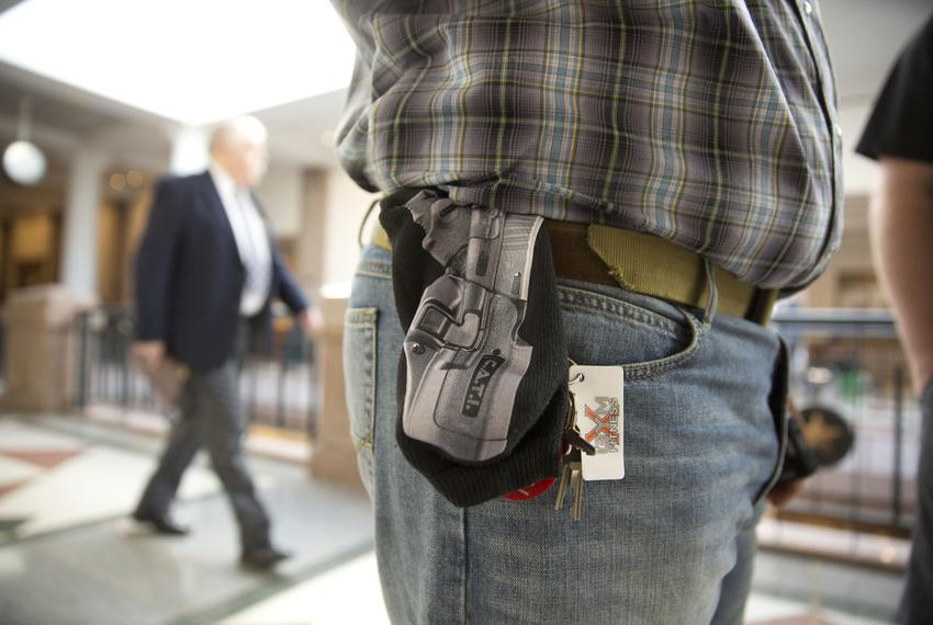 Jason Orsek with Come and Take it America wears a cloth gun holder with a photo of a gun imprinted on it at the Texas Capito…