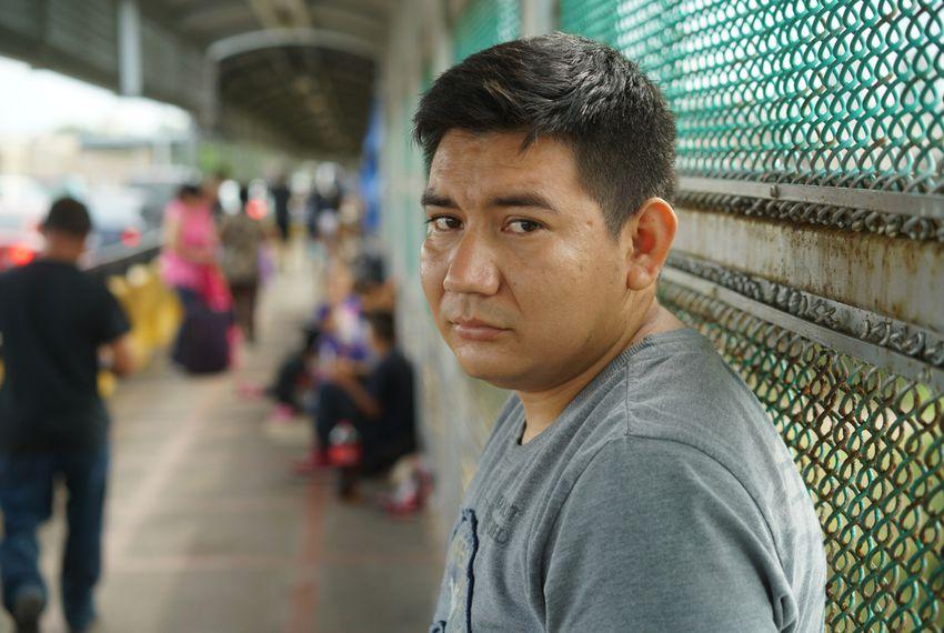 Marcos Samayoa waits on the Brownsville/Gateway International Bridge in June 2018.