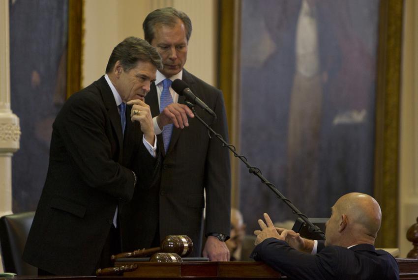 Gov. Rick Perry and Lt. Gov. David Dewhurst listen to Sen. John Whitmire, D-Houston, on Jan. 8, 2013, the opening day of t...