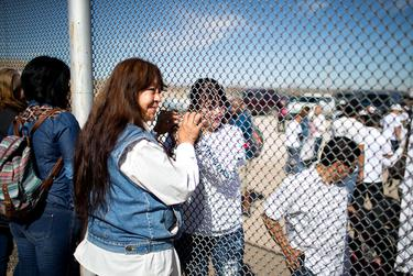 Maria Guadalupe Garcia Rodriguez of Juarez holds the hand of her daughter through the border fence in Juarez on Feb. 15, 2016. She has not seen her daughter, Linda Rodriguez, since she was 6 months old.