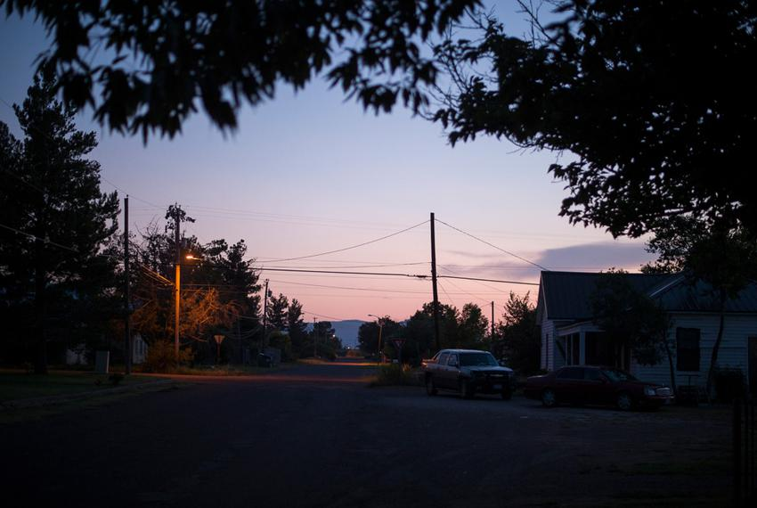The sun sets in a neighborhood near where the proposed Trans-Pecos pipeline is planned to run outside of Alpine.