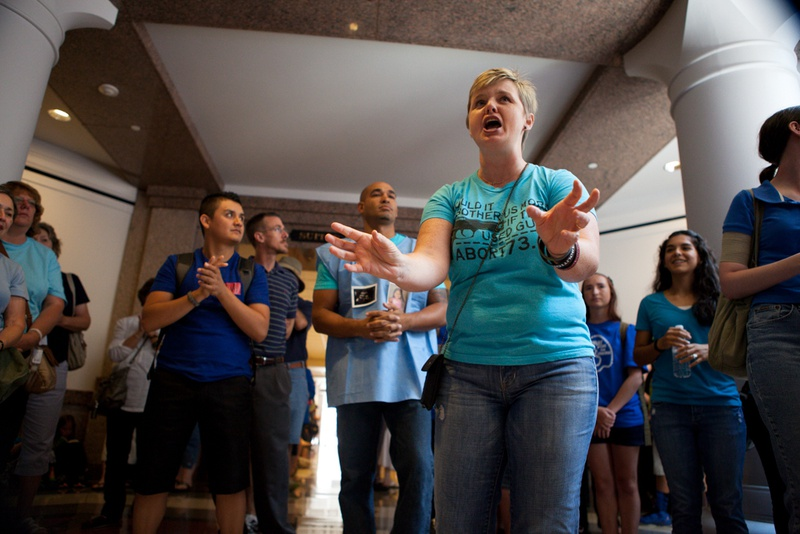 Pamela Whitehead, 39, of Katy, Texas speaks to other demonstrators opposed to abortion outside of the Texas State Capitol State Affairs Committee, July 2, 2013.