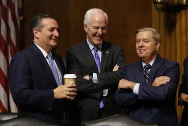 Left to right: Republican Sens. Ted Cruz, John Cornyn and Lindsey Graham during a break in the hearing on the nomination of Brett Kavanaugh to be an associate justice of the Supreme Court of the United States, on Capitol Hill in Washington, D.C. on Sept. 27, 2018.