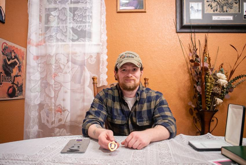 Joshua Raines, combat veteran and medical marijuana advocate, poses for a portrait with his Purple Heart. He was wounded i...