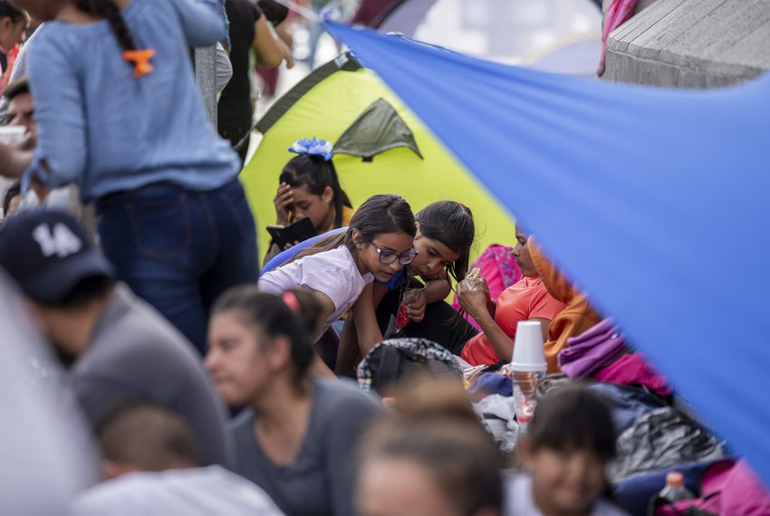 Migrants camp out at the base of the Paso del Norte International Bridge in Ciudad Juárez.