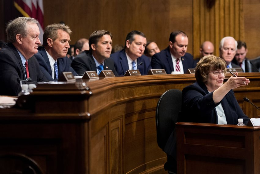 Rachel Mitchell, counsel for Senate Judiciary Committee Republicans, questions Christine Blasey Ford as Sens. Mike Crapo, Jeff Flake, Ben Sasse, Ted Cruz, Mike Lee and John Cornyn listen during the Senate Judiciary Committee hearing on Capitol Hill in Washington, D.C., on September 27, 2018.
