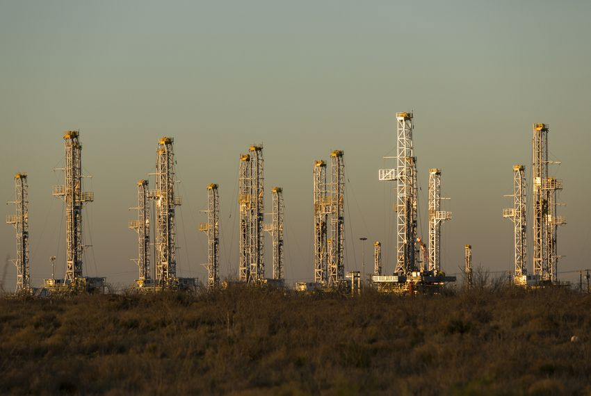 Dozens of stacked oil drilling rigs sit in a yard just north of Interstate 20 between Midland and Odessa.