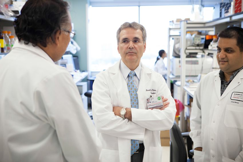 Ronald DePinho, president of the University of Texas MD Anderson Cancer Center, visiting labs on the south campus in Houston on Sept. 30, 2013.