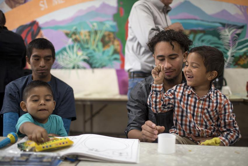 Pablo Ortiz and his 3-year-old son Andres (left), and Roger and his 4-year-old Roger Jr. (first names only given), speak a...