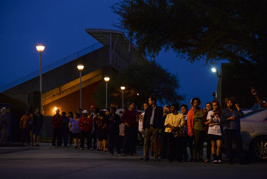 Voters wait in line to cast their ballot in the Democratic primary at a polling station in Houston on March 3, 2020.