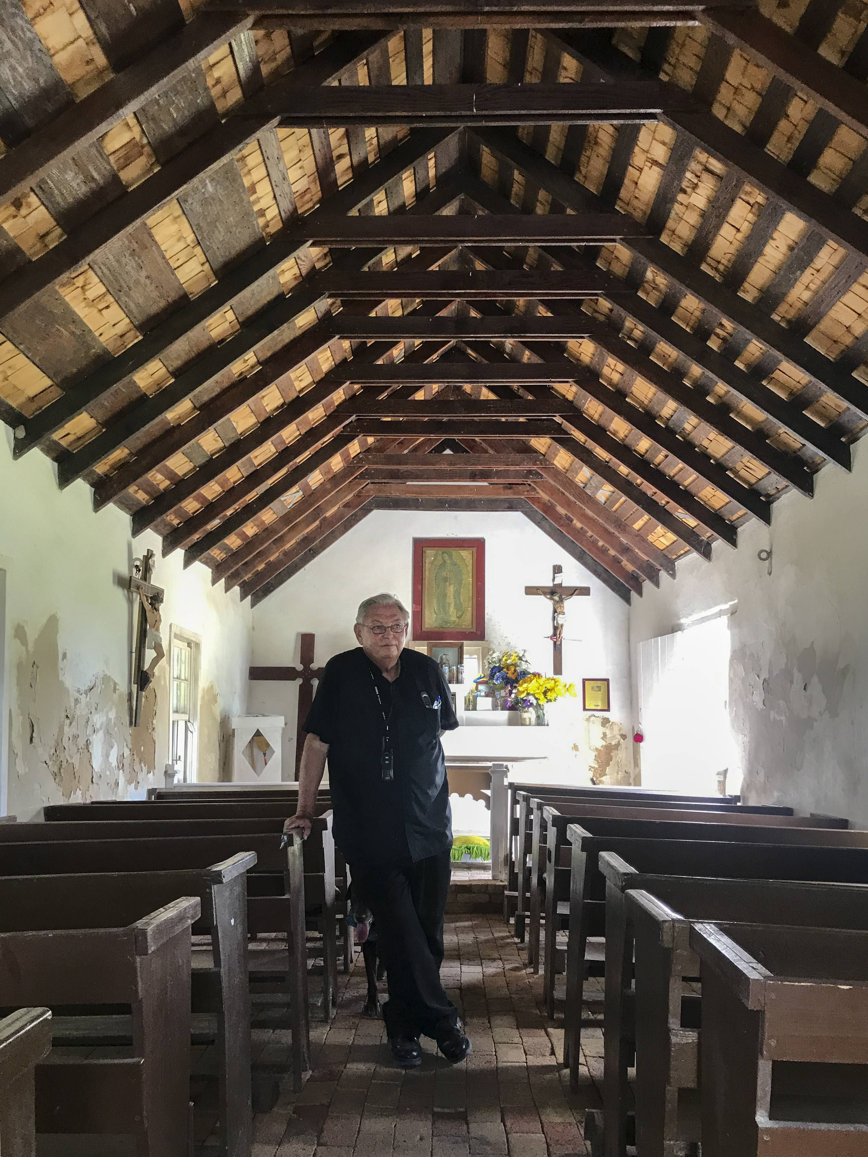 Father Roy Snipes inside La Lomita in October. Snipes has become a fierce defender of the chapel that gave Mission its name.