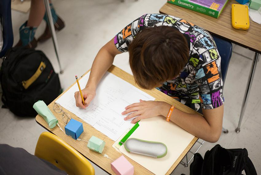 A student works on math problems in Keith Marquez's summer school geometry class at McAllum High School in Austin, Texas, Ju…