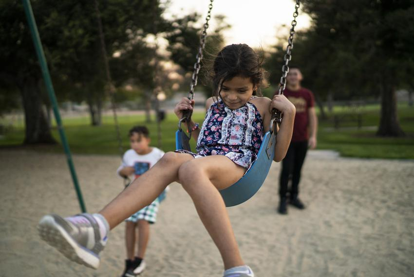 Heyli, her dad Carlos and her cousin Walter play in a park near their apartment in Los Angeles, California. Besides dealing …
