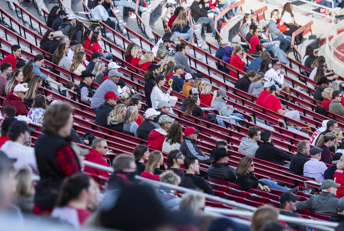 Fans in Jones AT&T Stadium watch Texas Tech's home coming game against West Virginia on Saturday in Lubbock. Texas Tech Athletics has reduced attendance to 25% of the general seating capacity of Jones AT&T Stadium. Oct. 24, 2020.