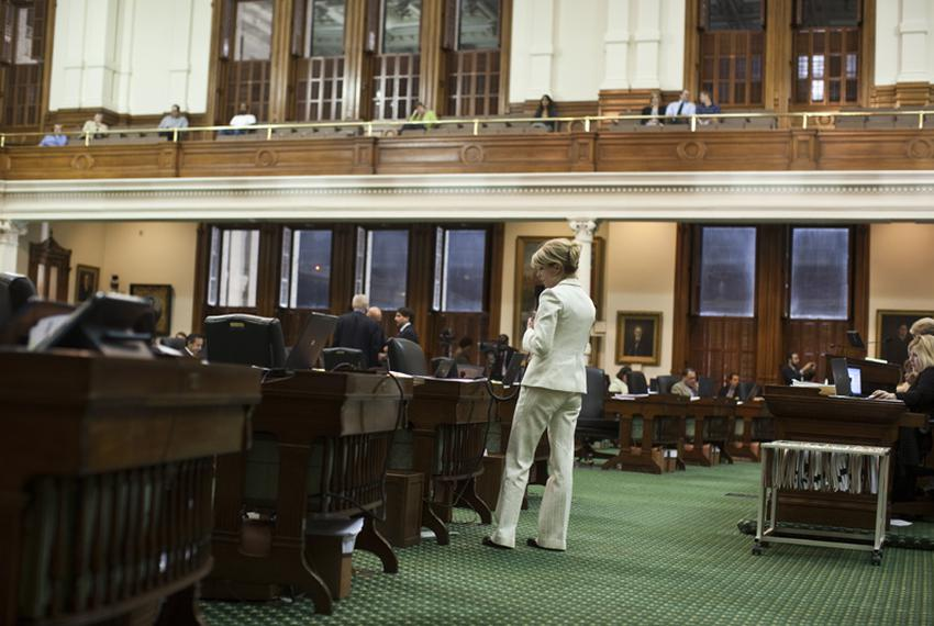 State Sen. Wendy Davis, D-Fort Worth, reads letters from her constituents on the Senate floor as she filibusters SB1811 on S…