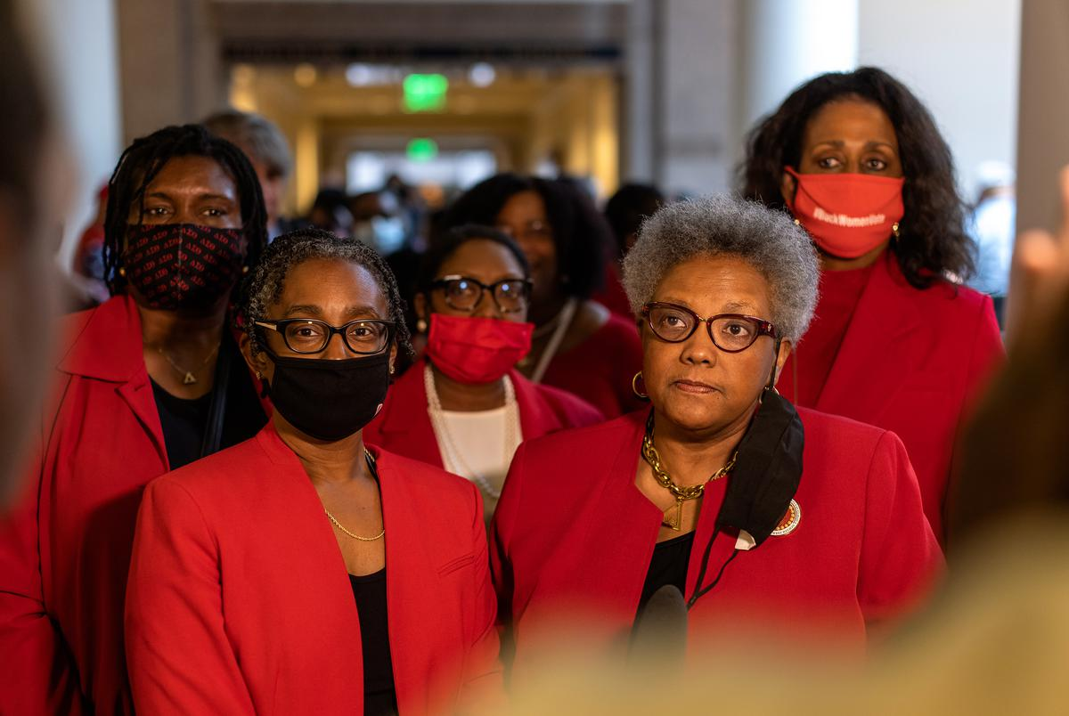 Michelle Brown, right, of Fort Worth, and her sisters from the Delta Sigma Theta sorority, were first in line to testify against House Bill 3, at the House Constitutional Rights and Remedies Committee hearing at the state Capitol on Saturday, July 10, 2021.