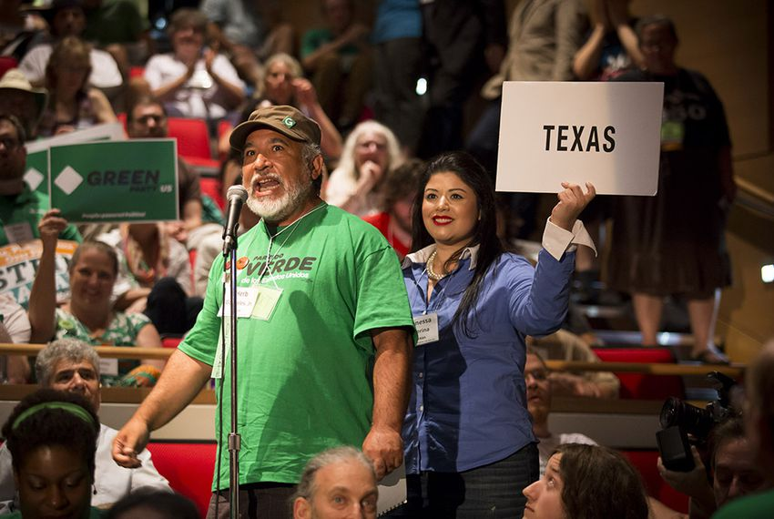 Texas delegate Herb Gonzales, Jr. announces the state's votes for president at the Green Party's national convention in Houston on Saturday, August 6, 2016.