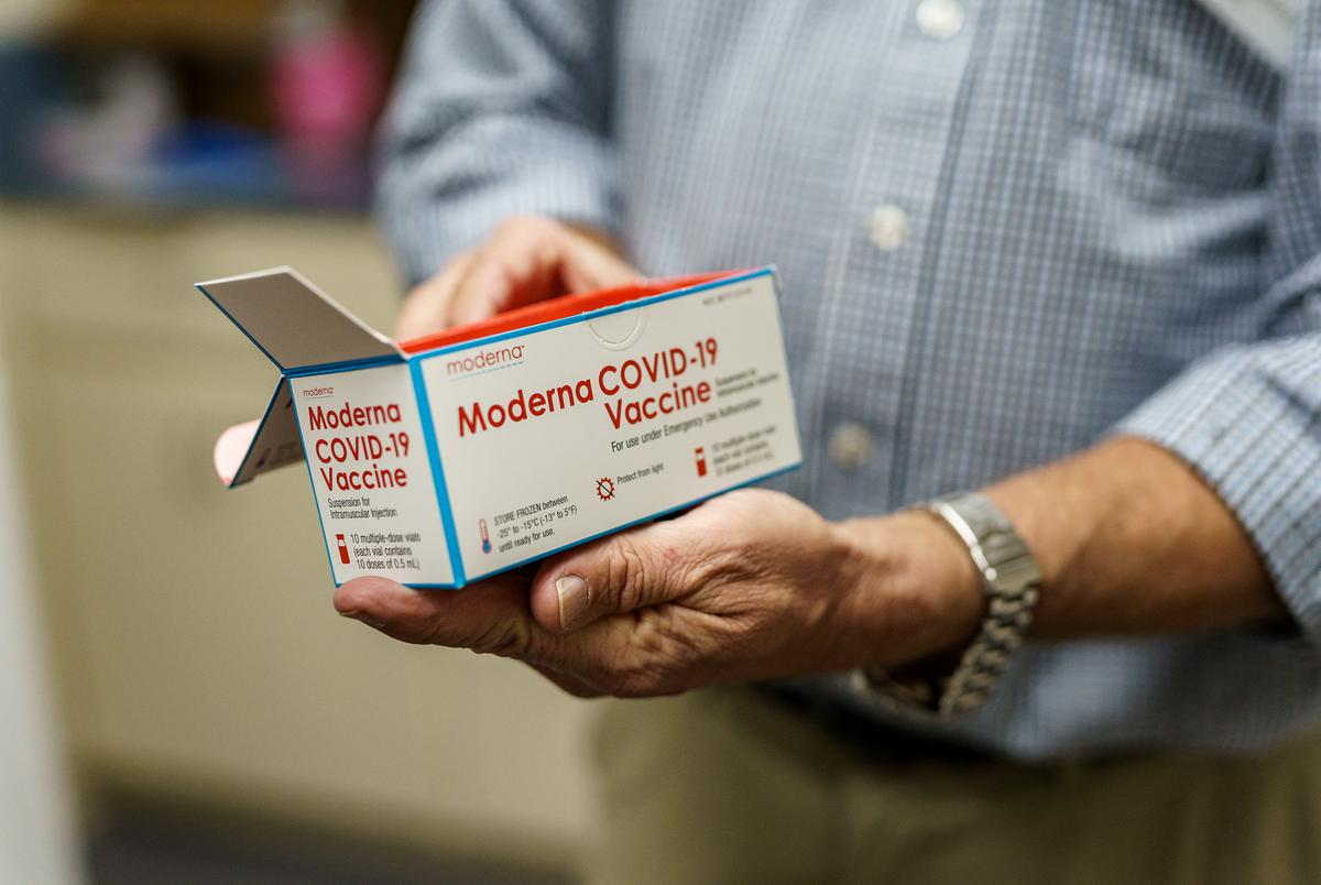 Empty Moderna COVID-19 vaccine containers stored in the box they were delivered in at 38th St. Pharmacy in Austin on Jan. 7, 2021.