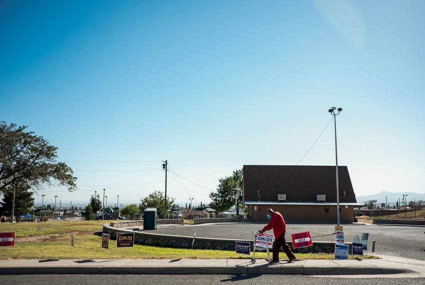 Francisco A. Morua, 95, walks home past campaign signs after casting his vote at the Grandview Senior Center on election day…