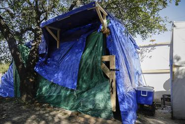 A constructed tent shelter along a median in Austin on Jan. 15, 2021.