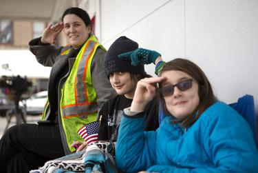 """Hayley Enoch, Zoey Johnson and Layla Johnson practiced their presidential salutes on Thursday. The trio arrived early in the morning to the train tracks near Washington Avenue in Navasota. """"It's significant to say goodbye to a decent president and humanitarian.  We also haven't had a presidential funeral train since 1969, when Eisenhower was buried,"""" said Enoch."""