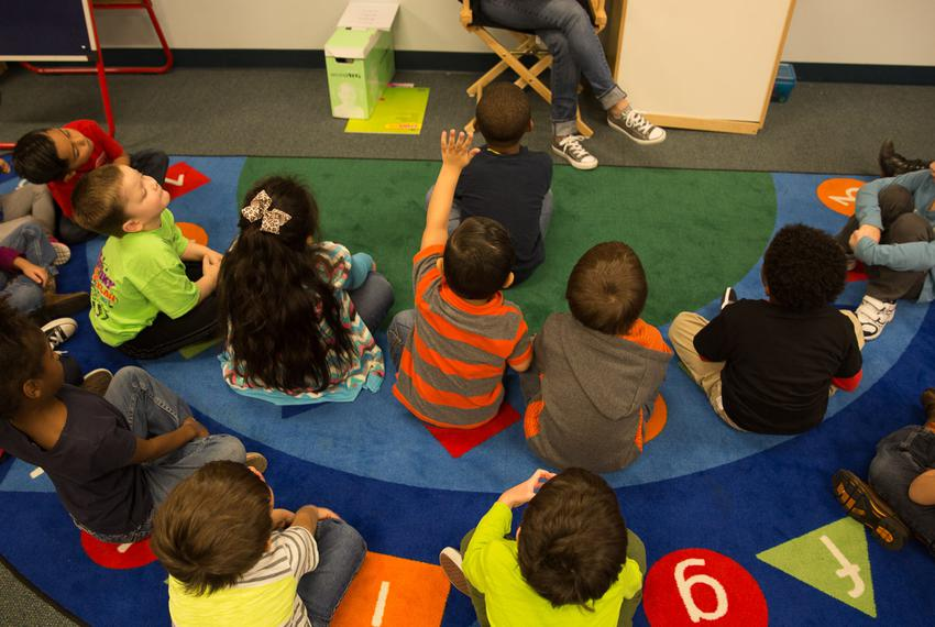 A student raises his hand during the class reading time at Union Hill Elementary School. Dec 7, 2015.