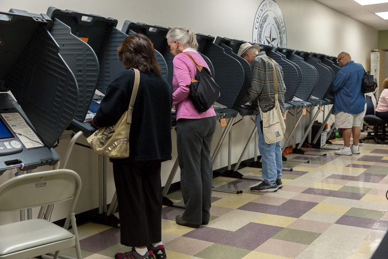 Travis County voters cast ballots at Travis County Tax Office on Feb. 25, 2016.