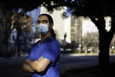 Steven D. Powell, a nurse with Texas Medical Center in Houston, poses for a portrait on Feb. 6, 2021.