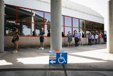 A line outside a polling location during the first day of early voting in Houston on Oct. 13, 2020.