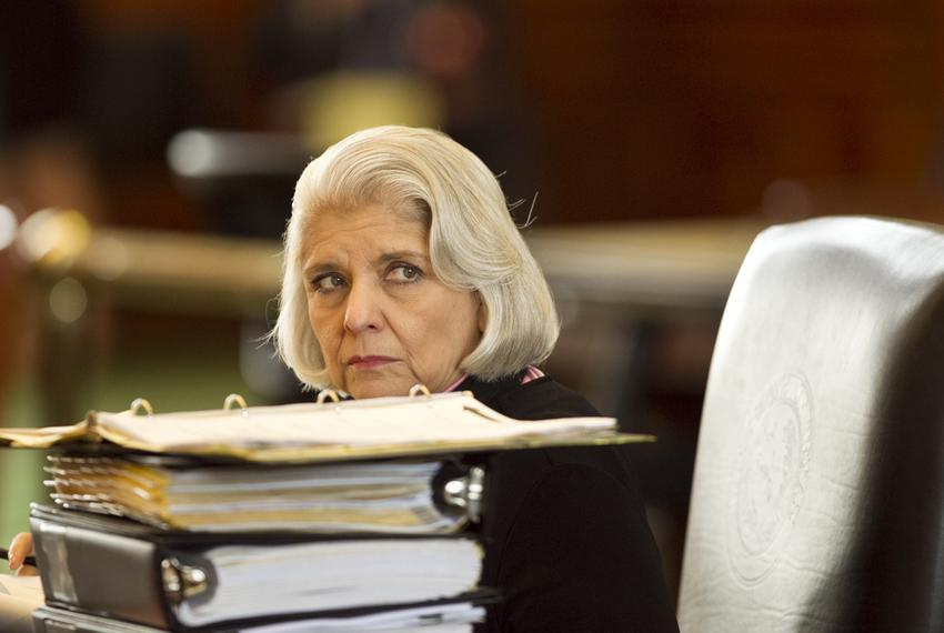 Sen. Judith Zaffirini D-Laredo, peeks over stack of binders at her desk during discussion of budget bill SB1 on March 20th, …