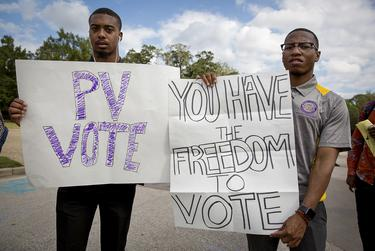 From left, Brizjon Wilright and Kendric Jones stand outside the Willie A. Tempton Student Center at Prairie View A&M to encourage other students to vote in 2016.
