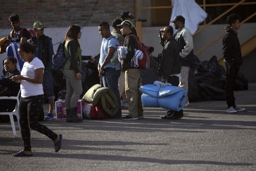 Migrants wait in line with their belongings inside of the shelter in Piedras Negras. Those with Mexican visas are allowed ...