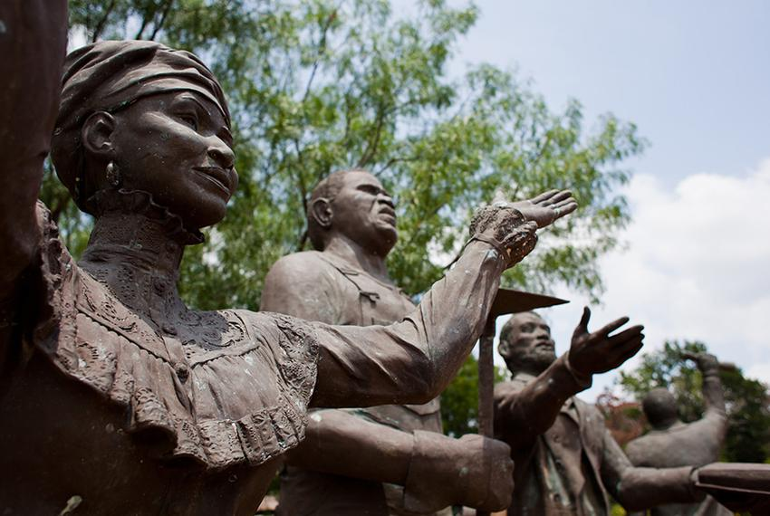 Statues built as a tribute to Juneteenth for the Texas Capitol grounds sit weathering at the Deep In The Heart of Texas Ar...