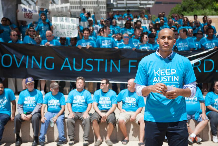 Uber's Austin General Manager, Macro McCottry, leads a march and rally against the proposal set by the Austin Transportati...