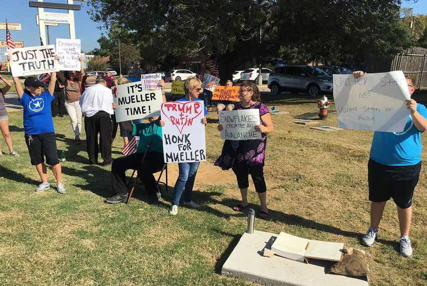Protesters gather outside the Lake Dallas office of U.S. Rep. Michael Burgess, R-Lewisville, to demand he protect special counsel Robert Mueller's Russia collusion investigation from interference by President Donald Trump, on Monday, Oct. 9, 2017