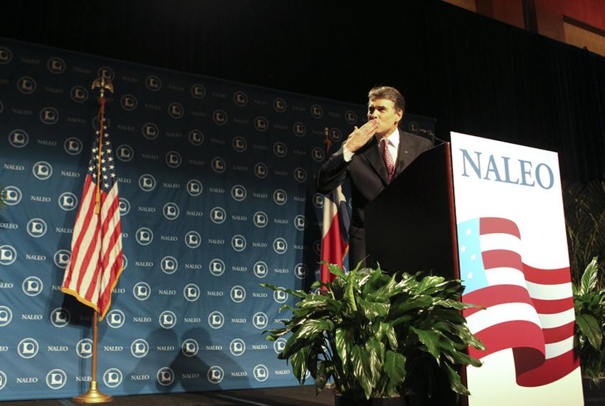 Texas Gov. Rick Perry blows a kiss to his Secretary of State Hope Andrade (not shown) during his speech to the National Assn…