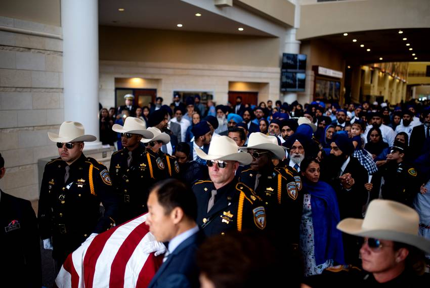 Thousands honor Harris County Deputy Sandeep Dhaliwal at his funeral at the Berry Center in Houston. The law enforcement c...