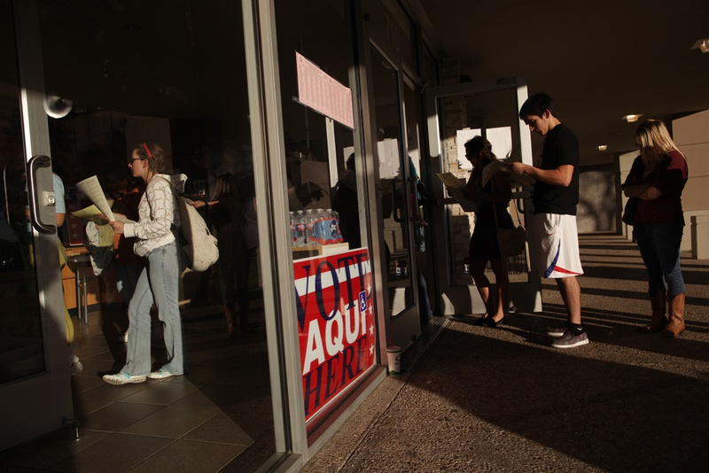 Voters wait in line to cast their ballots at a polling station in the Hancock Center on Tuesday Nov. 6, 2012 in Austin, Texas.