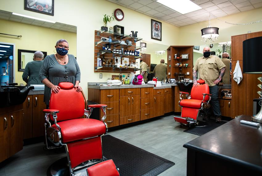 Barbers Lynese Marchic and her son Nicholas Gasper in their Austin shop on their first day open after closing during the cor…