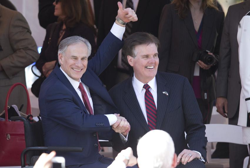 Newly sworn in, Gov. Greg Abbott and Lt. Gov. Dan Patrick watch the inaugural parade up Congress Avenue in Austin, Texas o...