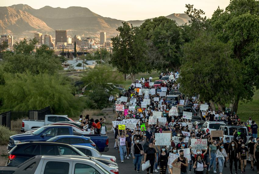 Demonstrators march down Copper Avenue toward the El Paso Police Department headquarters building during a protest over the …