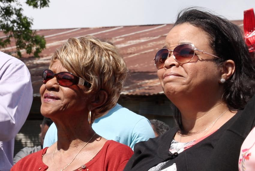 From left: Grover C. Everett's granddaughter, Margie Davis, and his great granddaughter, Aretha Alford, listen during the me…