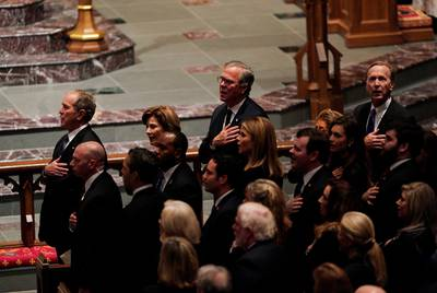 Members of the Bush family, including former President George W. Bush, Jeb Bush and Neil Bush, sing the U.S. National Anthem during the funeral service for former U.S. President George H.W. Bush at St. Martin's Episcopal Church on Thursday in Houston.