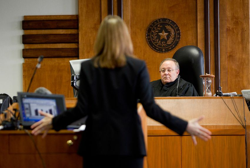 Shelley Dahlberg, an assistant attorney general, spoke to District Court Judge John Dietz of Austin on on Feb. 3, 2013, during closing arguments of a trial challenging the state's school finance system.