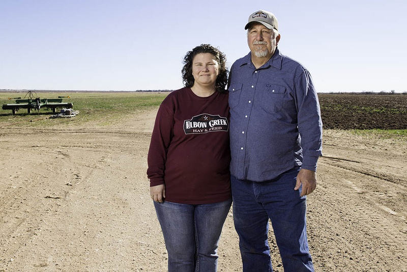 Hugh and Nancy Raney in front of a pair of fields, one currently fallow, on their farm near Big Spring. The couple had to stop farming part of their land when running the electric pumps to get well water to the fields became too expensive.