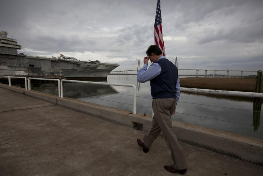 Republican candidate Rick Santorum walks alone toward the USS Yorktown for an early morning campaign event in Charleston, S.…