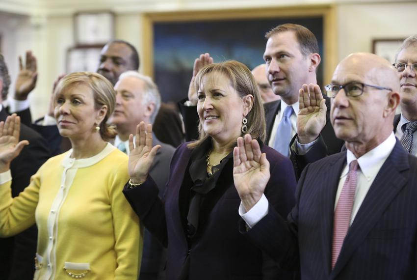 New Texas Sen. Konni Burton, c, stands with other incoming Senators during the swearing-in ceremony at the Texas Capitol Jan…
