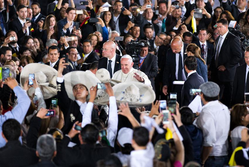 Pope Francis greets parishioners and a group of Mariachis as he is escorted by Mexican President Enrique Peña Nieto and his …