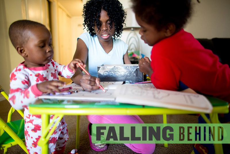Keshawn Johnson, then 20, colored earlier this year with her sons  (l-r) Keenan Mitchell, 20 months, and Kenny Mitchell, 3,  in their home in North Dallas.